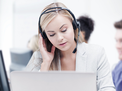 woman at anxiety call center talks on headset