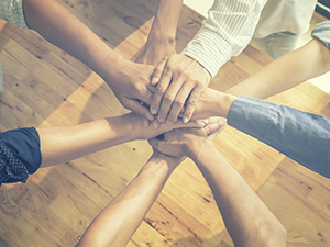 Binge eating disorder support group with hands in center