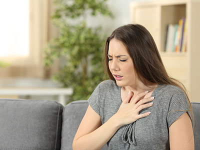 woman holding chest looking hurt, concept of withdrawal