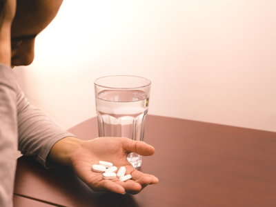 Woman looking at pills